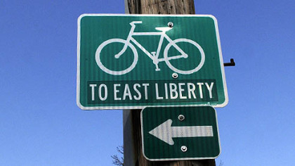 The City of Pittsburgh has signs suggesting bicyclists going to East Liberty turn off Penn Avenue on Brushton Avenue, where this sign points you down Meade Street.