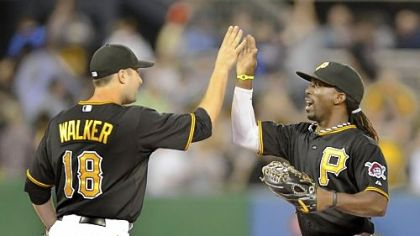 Pirates second baseman Neil Walker celebrates with center fielder Andrew McCutchen. Both have been key to the team&#039;s success this season.