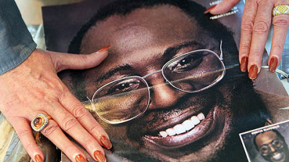Curtis Mayfield&#039;s widow, Altheida Mayfield, flips through old family albums of her late husband in Atlanta.