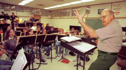 North Allegheny Band Director Frank Farina motions toward the cairnets during rehersal for the up coming Gargaro Production of &quot;Music Man &quot; at the Byham.