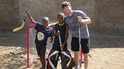 Penguins center Joe Vitale hangs out with two Haitian boys during a game of street hockey at the EBAC orphanage.