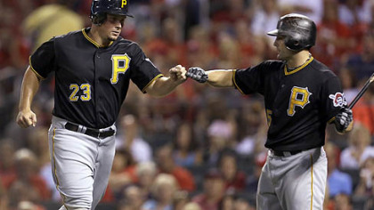 Travis Snider, left, is congratulated by Michael McKenry after scoring on a wild pitch by Cardinals starter Jake Westbrook during the fourth inning Friday night in St. Louis.