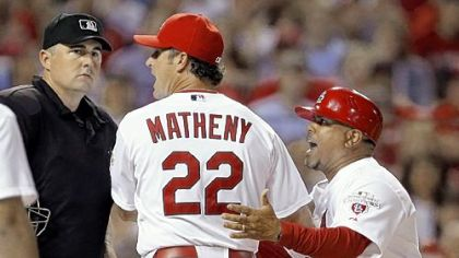 Cardinals manager Mike Matheny, right, argues with home-plate umpire Lance Barrett after Barrett threw Cardinals third-base coach Jose Oquendo out of the game in the sixth inning.