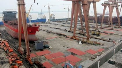 Unfinished tankers sit idle at Dongfang Shipbuilding in Yueqing County, China. Small and medium Chinese shipbuilders have been devastated by overcapacity and sinking freight rates.