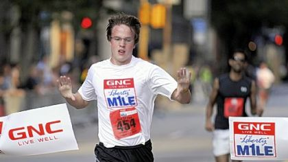Eric Rauterkus of the South Side wins the recreational mile in 5:21 at the GNC Live Well Liberty Mile race Friday night, which started in the Strip District and ended Downtown.