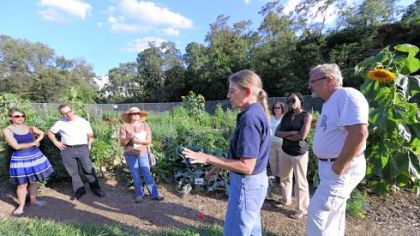 Gardeners listen as Sandy Feather of Penn State speaks at a Pittsburgh community garden.