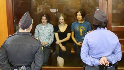 Members of the all-girl punk band Pussy Riot -- from left, Yekaterina Samutsevich, Maria Alyokhina and Nadezhda Tolokonnikova -- sit in a glass-walled cage Friday as a Moscow court handed a two-year jail sentence to the feminist rockers.