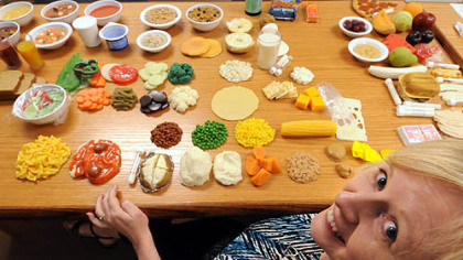 Diabetic nurse educator Linda Reichart presides over a banquet of plastic food showing exactly the proper serving size for patients needing information on diabetes at the Community Health Clinic of Butler.