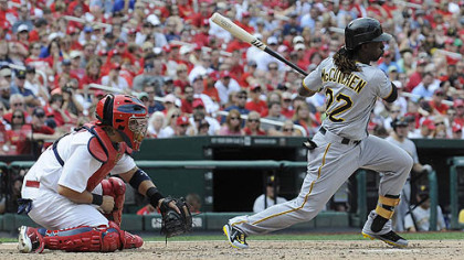 The Pirates' Andrew McCutchen hits a one-run single, which scored Jeff Karstens during the sixth inning against the Cardinals Sunday in St. Louis.