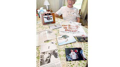 Clara White, 88, sits with various forms of memorabilia inside her home in Wapwallopen, Pa. Ms. White planned to sky-dive for the eighth time in honor of her 88th birthday.