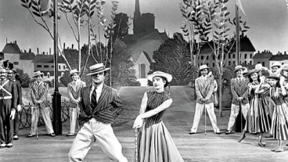 "Gene Kelly and Leslie Caron in the 1951 film ""An American in Paris."""
