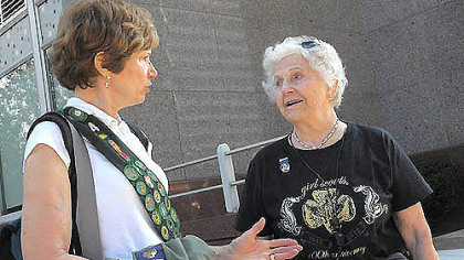 "Virginia Halt, 92, shown here at right with her daughter Sandra Fischer, was honored by the Girl Scouts for more than 30 years of service as part of today's parade Downtown celebrating the organization's 100th anniversary. The parade theme was ""100 Years of History and a Future of Possibilities."""