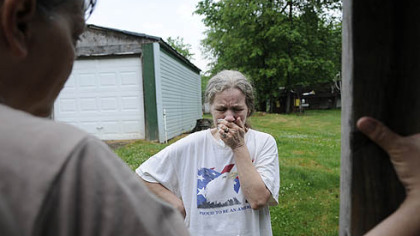 Barb Romito breaks down after water delivery coordinator Janet McIntyre tells her that an anonymous sponsor will pay for her water buffalo (or tank) for another month.  
