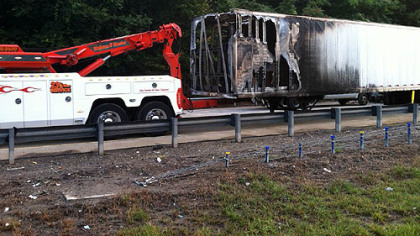 Part of the trailer of the mail truck that caught fire early Monday morning along Interstate 279.