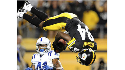 Steelers receiver Antonio Brown flies past Colts safety Antoine Bethea for a touchdown in the first quarter Sunday at Heinz Field.