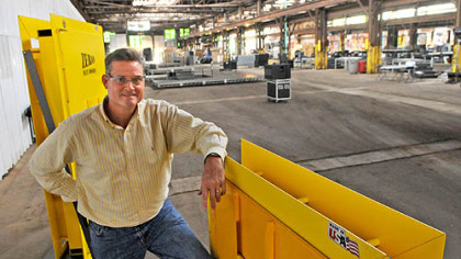 Beaver Steel Services President Tony Treser stands with two types of mining doors made at the plant in Rosslyn Farms. The warehouse is where the Mitt Romney campaign will hold a rally Tuesday with vice presidential candidate Paul Ryan.