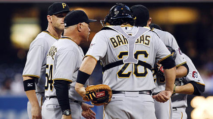 Pittsburgh Pirates pitching coach Ray Searage, second from left, meets with pitcher Kevin Correia on the mound during the first inning against the Padres on Monday in San Diego. Pirates catcher Rod Barajas stands at right.