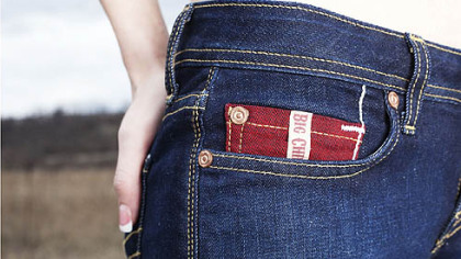 Big Chief jeans logo on a red coin pocket, apparel designed by Brookline-based James Houk.