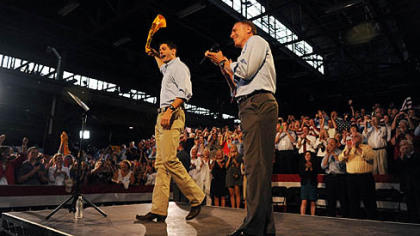 Paul Ryan waves a Terrible Towel on stage with Tim Murphy in Rosslyn Farms.