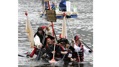 Festivals: Despite taking on water, the Leaky Pearl Pirate float, sailed by a group of friends from Mt. Lebanon, took second place in the Anything That Floats Race on the Allegheny River during last year's Three Rivers Regatta.
