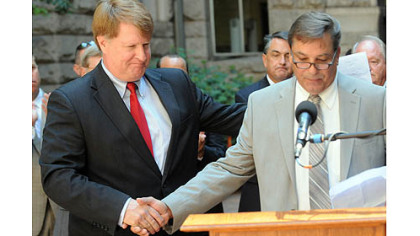 Allegheny County Executive Rich Fitzgerald, left, introduces transit union Local 85 president Steve Palonis at a news conference Tuesday announcing a funding solution to avoid Port Authority service cuts.