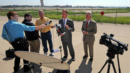 U.S. Rep. Tim Murphy, center, and state Auditor General Jack Wagner, right, answer reporters' questions after a tour of the 911th Airlift Wing Air Force Reserve Base at the Pittsburgh International Airport. The two continue to seek information from the Air Force on why the base has been selected for closure.