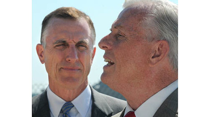 Rep. Tim Murphy, R-Upper St. Clair, left, and state Auditor General Jack Wagner speak Wednesday after a tour of the 911th Airlift Wing Air Force Reserve Base at Pittsburgh International Airport. The two continue to seek information from the Air Force on why the base has been selected for closure.