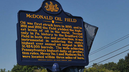 The historical marker noting the importance of the 19th century McDonald Oil Field was unveiled.