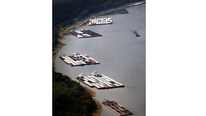 Barges are stuck Tuesday near Greenville, Miss., due to low water on the Mississippi River. The tugs pushing them were waiting for dredging work to open the main channel.