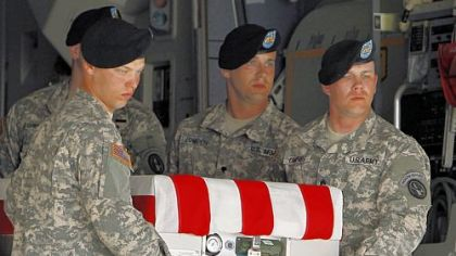 An Army carry team moves a transfer case containing the remains of Staff Sgt. Eric S. Holman at Dover Air Force Base, Del., Saturday, Aug. 18, 2012. According to the Department of Defense, Holman, of Evans City, Pa., died while supporting Operation Enduring Freedom in Afghanistan. (