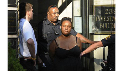Police take Breona Moore, 19, of East McKeesport into custody on Thursday at the Investment Building on Fourth Avenue.