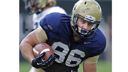 Pitt's J.P. Holtz goes through drills at practice Tuesday on the South Side.