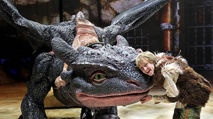 "Hiccup (Riley Miner) becomes friends with dragon Toothless in the ""How to Train Your Dragon Live Spectacular."""