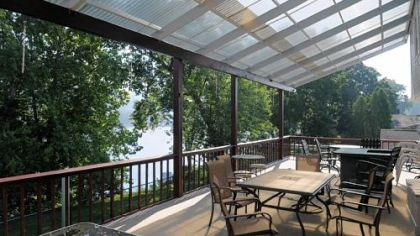 The covered deck of 7210 Front River Road, Neville Island, which is on the market for $398.000.