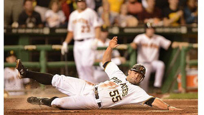 Catcher Michael McKenry slides safely in to home plate to score one of the Pirates&#039; four runs against the Brewers in the fifth inning Saturday at PNC Park.