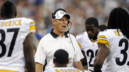 The Steelers&#039; defensive coordinator talks to his squad during a timeout against Buffalo in the first quarter.