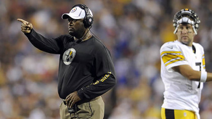 Steelers head coach Mike Tomlin signals to his team against Buffalo in the second quarter.