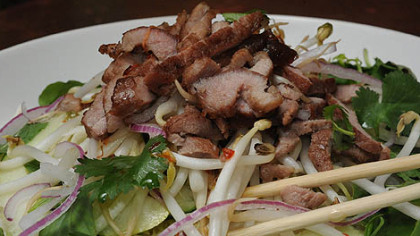 Vietnamese grilled pork noodle salad ($8.50) -- which includes grilled strips of pork served on a bed of rice vermicelli with fresh mint, basil, peanuts, bean sprouts and shredded raw vegetables in a spicy sweet dressing -- is a delicious entree at Spice Island Tea House in Oakland.