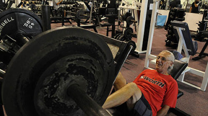 David Julian, 72, works out with the leg press at Streamline Fitness, McKees Rocks. He says he works out 2 hours a day.