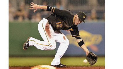 Pirates shortstop Clint Barmes can not catch up to ball hit up the middle by the Cardinals starting pitcher Kyle Lohse for a single Monday at PNC Park.