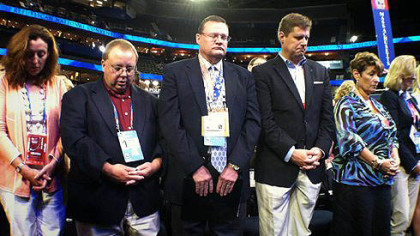 The Republican National Convention in Tampa opened with prayer. These are members of the Massachusetts delegation.