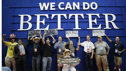 Ron Paul supporters pose for a picture after an abbreviated session of the Republican National Convention.