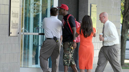 Wide receiver Mike Wallace enters the Steelers' South Side facility on Tuesday.