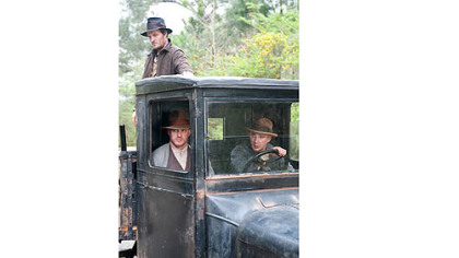 "Jason Clarke, Tom Hardy and Shia LaBeouf portray moonshining brothers in ""Lawless."""