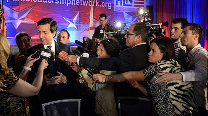 Puerto Rico Gov. Luis Fortuno was mobbed by reporters at a Hispanic Leadership Network event on Tuesday.