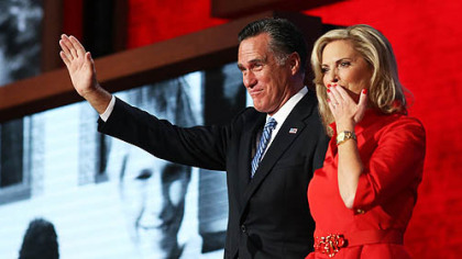 Republican presidential candidate Mitt Romney joins his wife, Ann Romney on stage during the Republican National Convention at the Tampa Bay Times Forum.