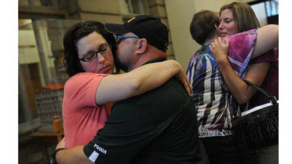 Joy Burkholder, left, receives a hug from her husband, Lance, Thursday after Melvin Knight was sentenced to death for the torture and murder of Jennifer Daugherty at the Westmoreland County Courthouse in Greensburg. Ms. Burkholder is Jennifer&#039;s sister. Heather Smitley, right, hugs Daugherty&#039;s mother, Denise Murphy.