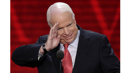 Sen. John McCain, R-Ariz., salutes before addressing the Republican National Convention in Tampa, Fla.