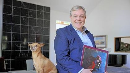 "Economist Mike Moebs, seen here with his dog Missy, revamped his personal and business trusts to include all his digital assets, including the Janis Joplin album ""Pearl."""