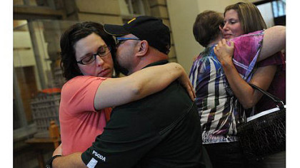 Joy Burkholder, left, receives a hug from her husband, Lance, after Melvin Knight is sentenced to death for the torture and murder of her sister, Jennifer Daugherty, Thursday at the Westmoreland County Courthouse in Greensburg. Heather Smitley, right, hugs Daugherty's mother Denise Murphy.